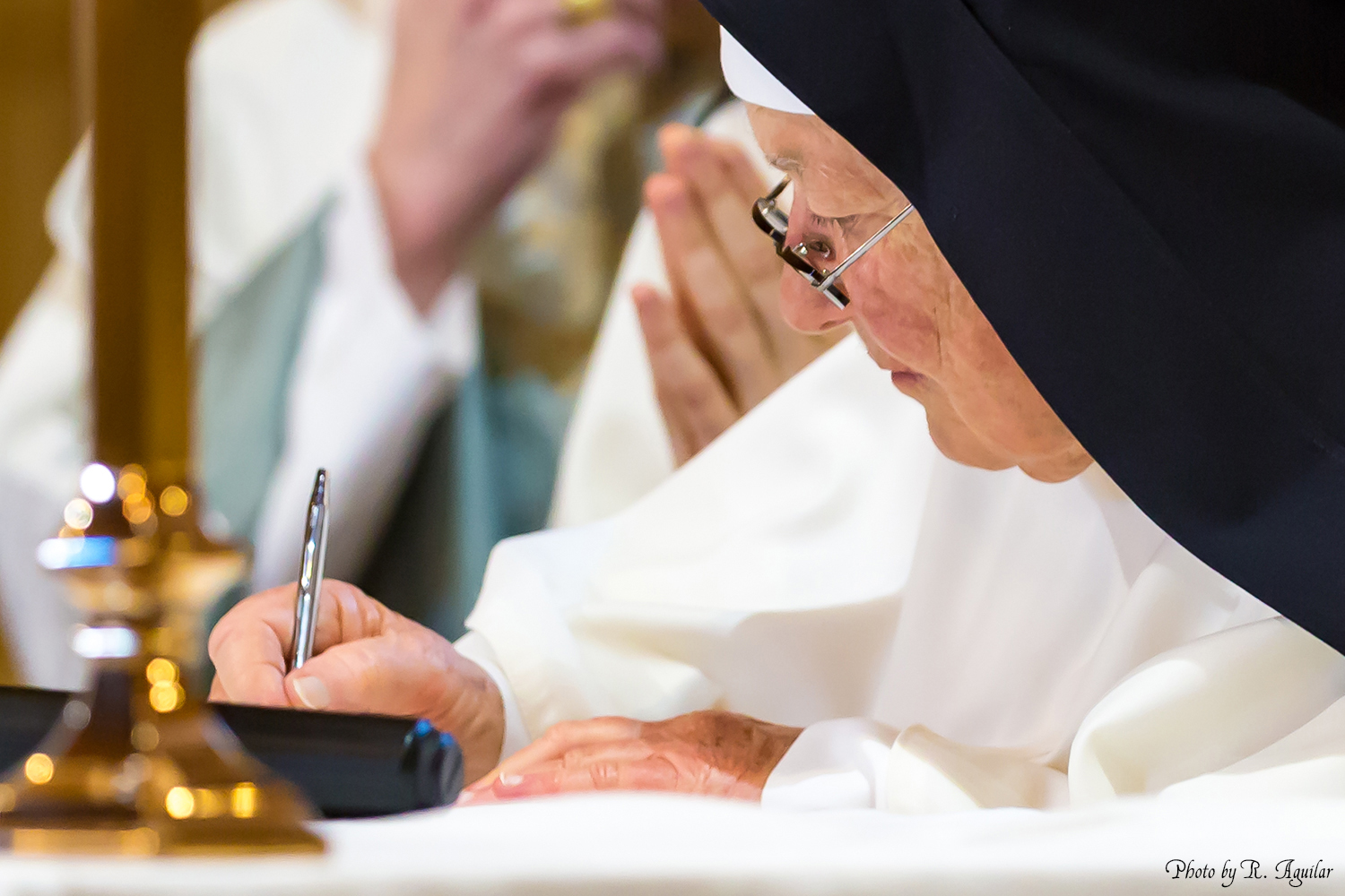 22 Prioress signing the formula of profession
